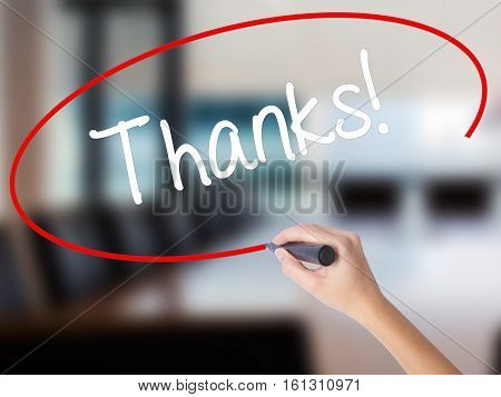 Woman Hand Writing Thanks! With A Marker Over Transparent Board