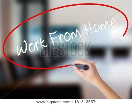 Woman Hand Writing Work From Home With A Marker Over Transparent Board