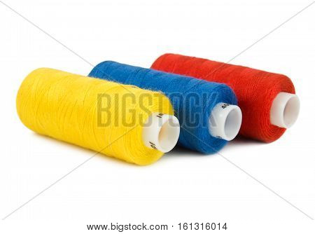 Three spools of threads on a white background