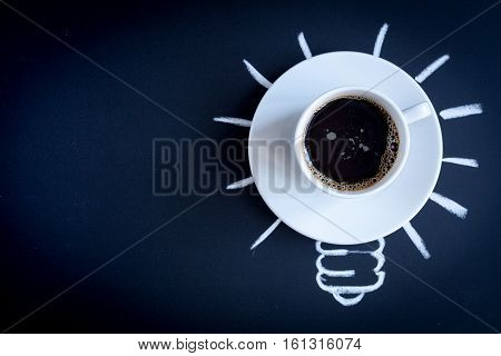 concept coffee awakens brain on dark background top view.