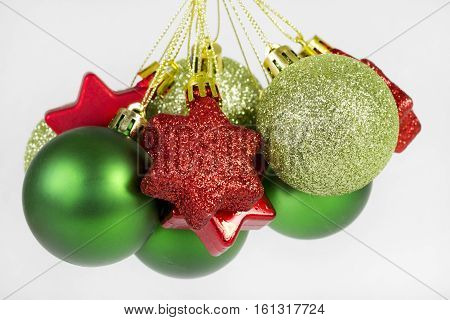 Group of christmas balls and stars over a white background.