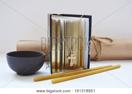 symbols of Christianity, the Bible, the cross, wax candles, a Cup of incense