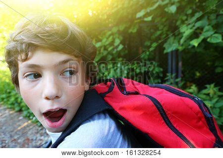 teen handsome boy hiking with backpack on bicycle close up photo