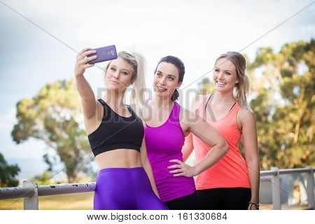 Three Fitness Women Taking A Selfie After Excersise