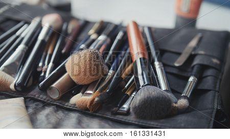 Close-up view of make-up brushes, horizontal macro