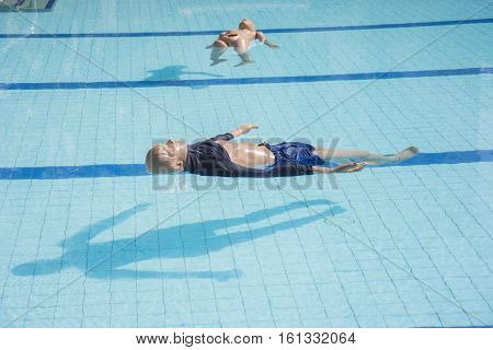 dummy drowning training adult and child float in the pool