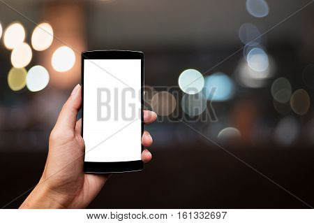 man using smart phone with blank mobile. Smart phone with blank screen and can be add your texts or others on smart phone. night light bokeh background