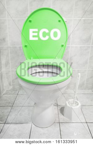 Toilet bowl with green seat in a modern bathroom. Homemade production of biomass and biogas. Renewable energy for your home. Digital artwork on environmentally theme. Picture with text space.