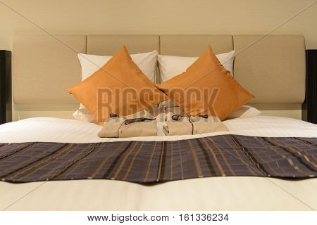 Pillows and nightgown on bed modern bedroom