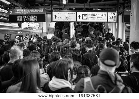 YOKOHAMA, JAPAN - NOVEMBER 7, 2016: People traveling by very popular Municipal Subway in Yokohama, Japan. Yokohama Municipal Subway is the metro network in the city of Yokohama, Japan