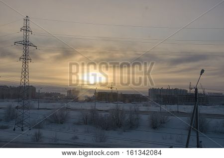 Cold winter sunset when the temperature outdoor is - 50 degree by Celsius. North. At the polar circle