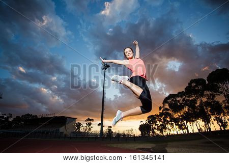 Beautiful Female Fitness Model Stretching And Training On Athletics Track