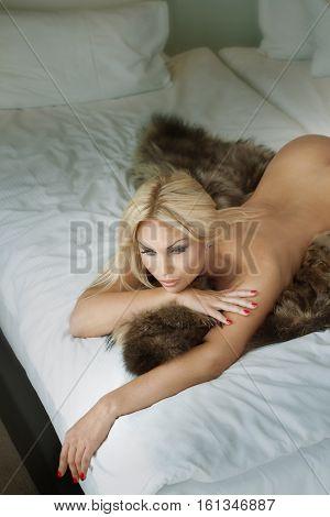 Sensual Blonde Woman Lying In Bed.