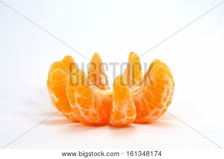 Bowl of tangerine parts on a white background