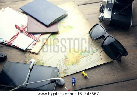 map camera glasses pasport on wooden table