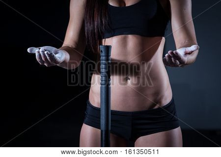 Female Fitness Model Clapping Hands With Talc Powder.
