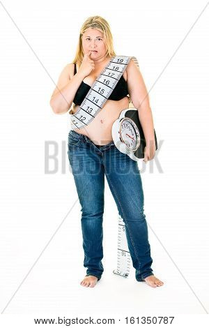 Large Young Woman With Weighing Scales Under Arm