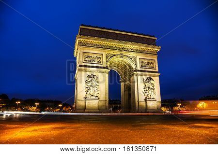 The Triumphal Arch (Arc de Triomphe) in Paris France at night