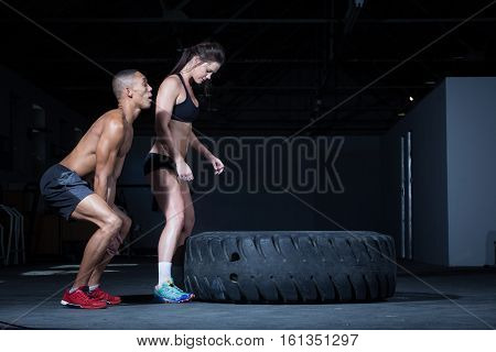 Personal Trainer Doing A Tyre Flip In A Gym