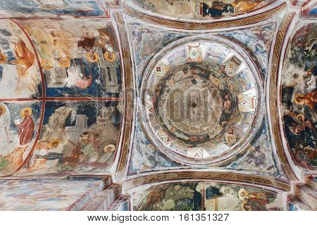 KUTAISI, GEORGIA - SEP 22, 2016: Surface with old frescoes under the dome of medieval cathedral Gelati on September 22, 2016. Gelati monastery built in 12th century UNESCO World Heritage Site