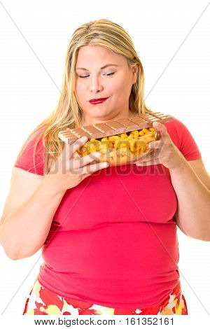 Overweight Woman With Bowl Of Chips And Chocolate