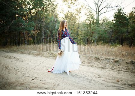 fine young woman wearing a wedding dress with a plaid shirt
