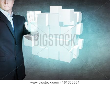 Businessman hand put together small cubes into big. Problem solving concept