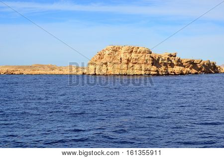 Egypt Sharm El Sheikh the rock against the sky. Desert. Egyptian mountains. Red sea. Sea Rock. Coral Reef. Fish.