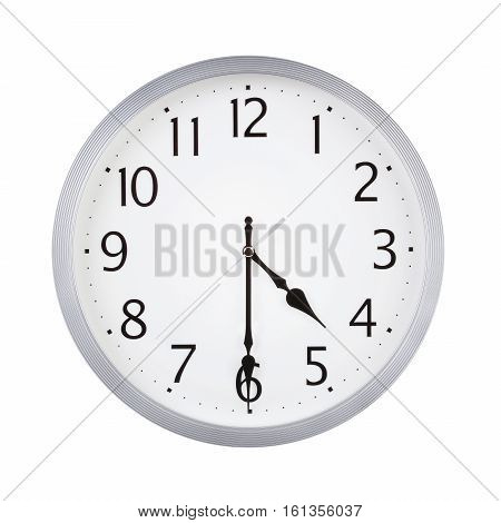 Half past four on the round clock dial
