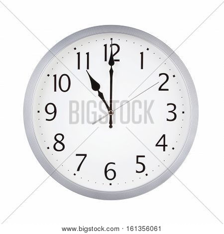 Eleven o'clock on the round clock dial