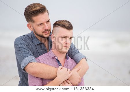 Close Up Image Of A Same Sex Or Gay Male Couple Being Loving And Happy On The Beach In Cape Town Sou