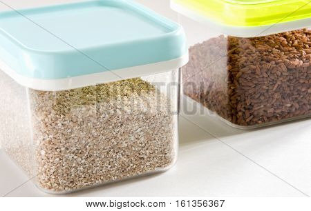 Food storage. Food ingredients (cut wheat and barley) in plastic containers. Selective focus.
