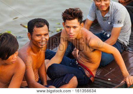 Tonle Sap Lake Siem Reap, Cambodia - OCTOBER 13, 2012: Young asian people are floating in a boat.. The life of the local residents