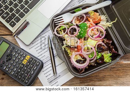 Healthy quinoa and mix of lettuce in a lunch box