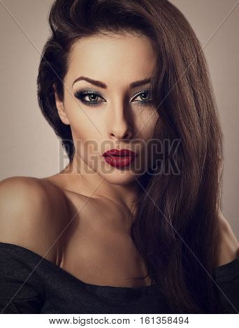Seductive Make Up Sexy Woman With Red Lipstick And Long Eyelashes Looking Vamp On Dark Background. C