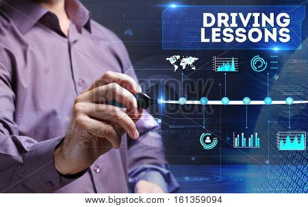 Technology, Internet, Business And Marketing. Young Business Person Sees The Word: Driving Lessons