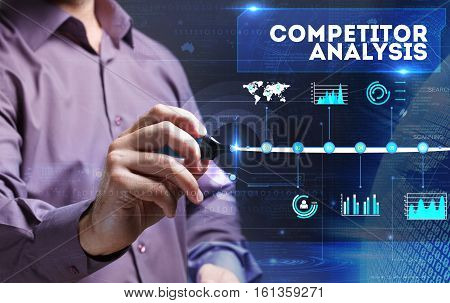 Technology, Internet, Business And Marketing. Young Business Person Sees The Word: Competitor Analys