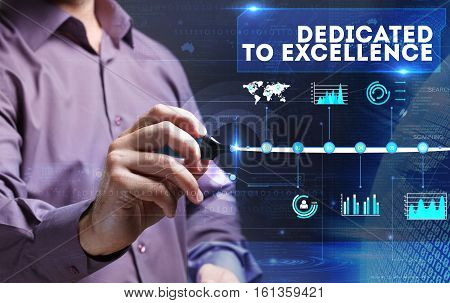 Technology, Internet, Business And Marketing. Young Business Person Sees The Word: Dedicated To Exce