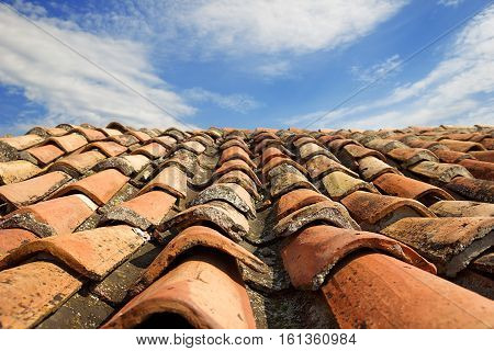 Vintage natural tile roof on the blue sky background
