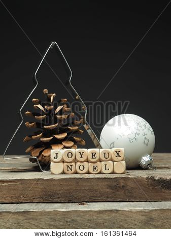 French Christmas background with the words Joyeux Noel selective focus on the wooden dices