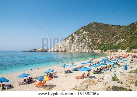 KEFALONIA ISLAND, GREECE - August 8, 2015: People relaxing at the beach of Petani, Kefalonia island, Greece.