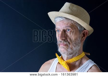 Crazy senior man with a hat and bow tie arround his neck