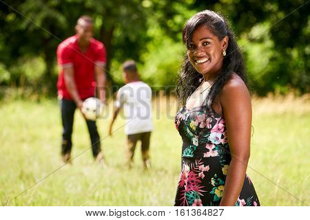 Portrait Of Happy Black Woman Looking At Camera With Family