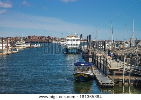 Boston, USA - April 28, 2015: Pier of Boston Wharf with sailboat in Charles River Boston Massachusetts the United States.
