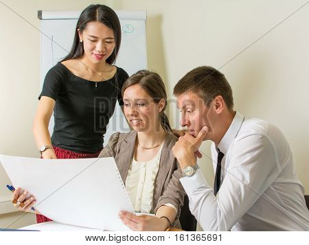 Multicultural Team Looking At A Project