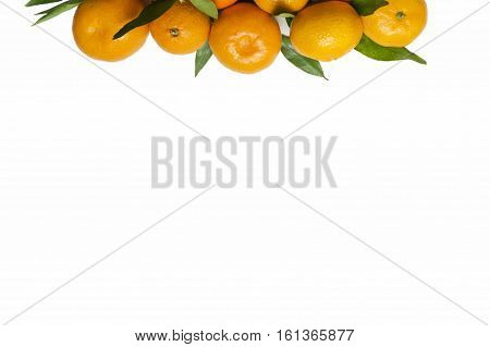 Mandarins at border of image with copy space for text. Top view. Tangerines close-up on a white background. Background tangerines.
