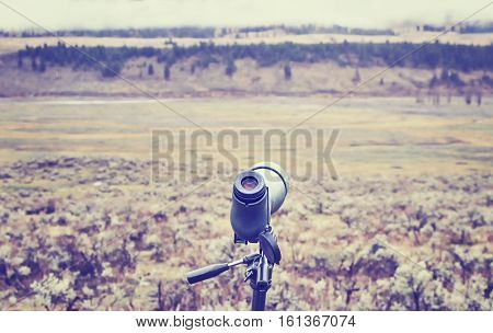 Vintage Toned Telescope Used By Wildlife Watchers And Hunters.
