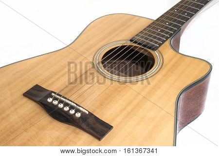 Wooden Acoustic Guitar Isolated Over White Background