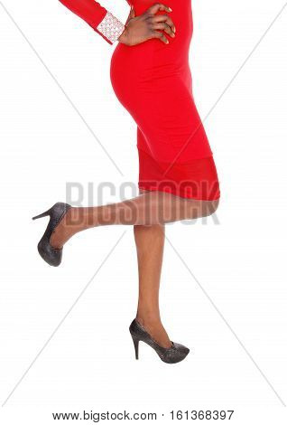 A closeup image of the legs and butt of a slim African American woman in a red dress isolated for white background.