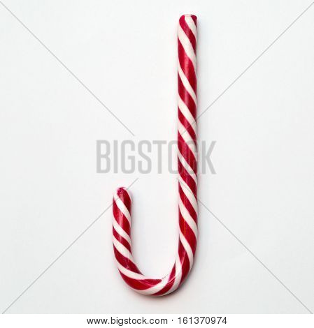 Red White Striped Candy Cane on Light Background